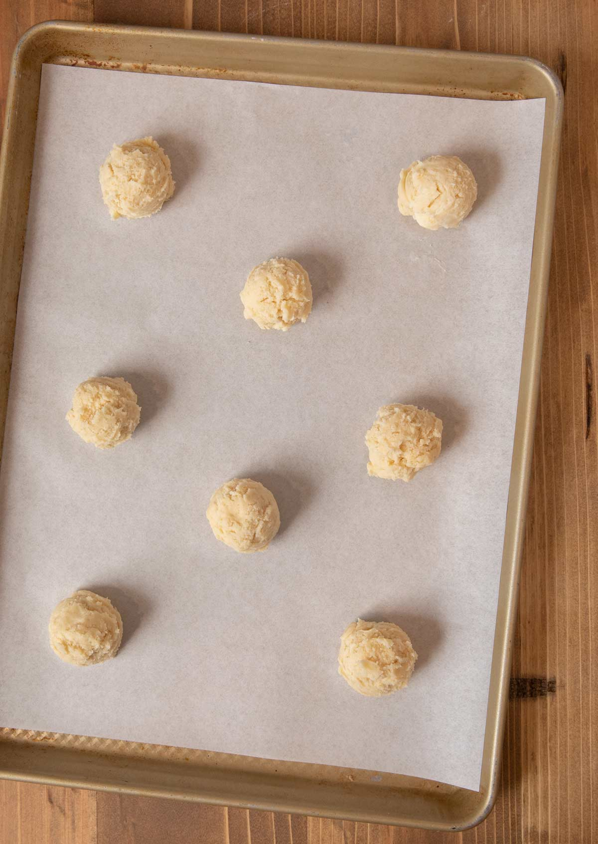 Cream Cheese Cookies dough balls on cookie sheet