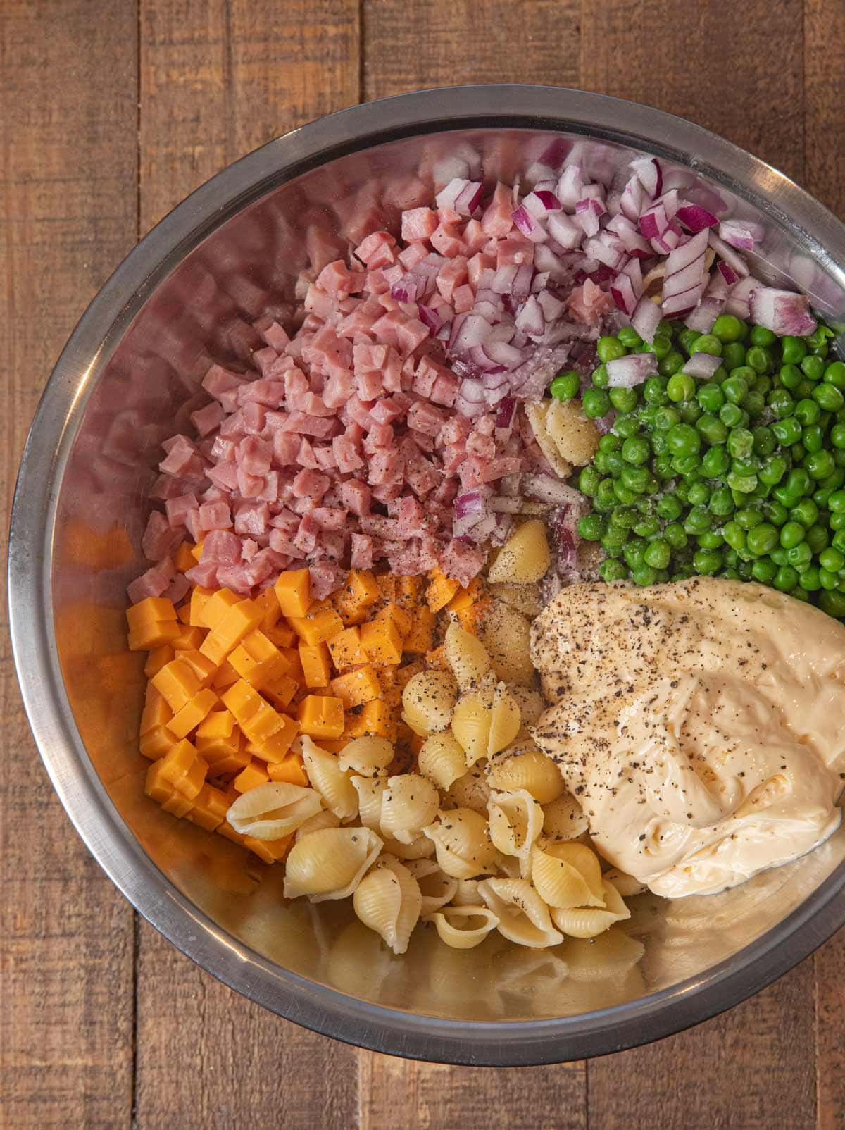 Ham and Cheese Pasta Salad ingredients in mixing bowl