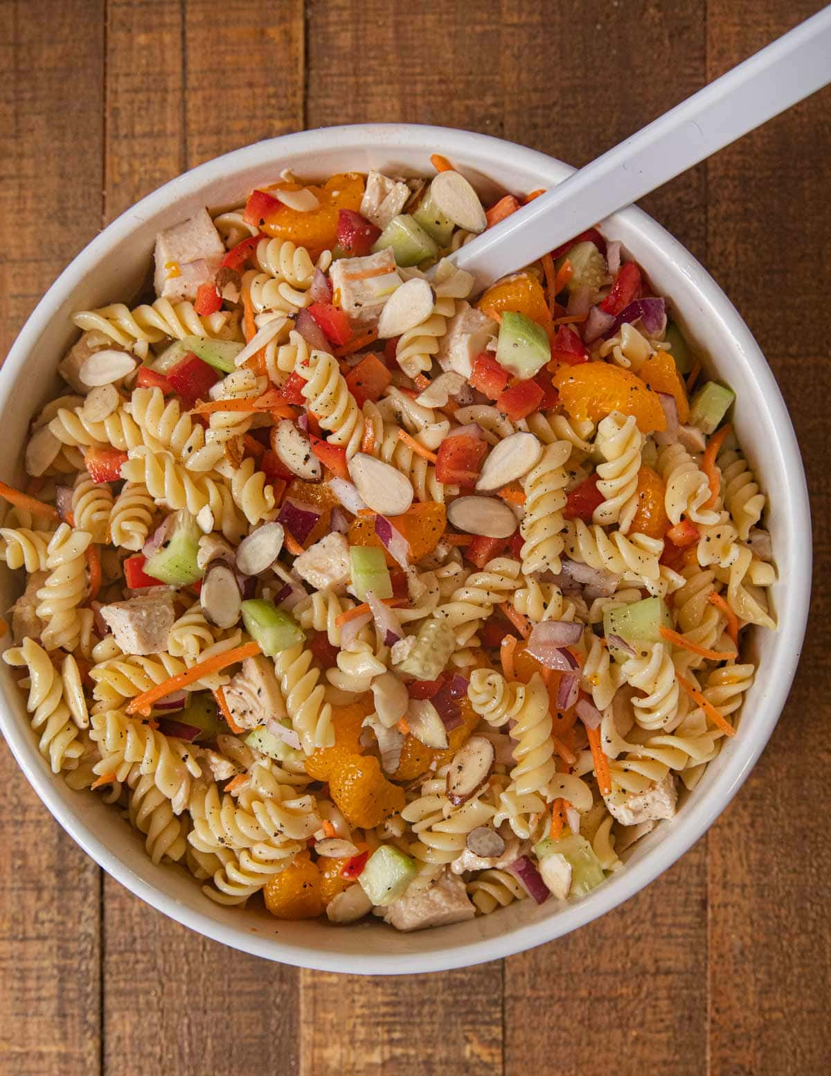 Mandarin Chicken Pasta Salad with ingredients mixed together
