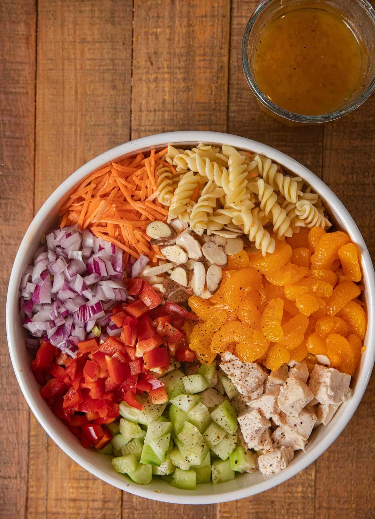 Mandarin Chicken Pasta Salad ingredients in white bowl