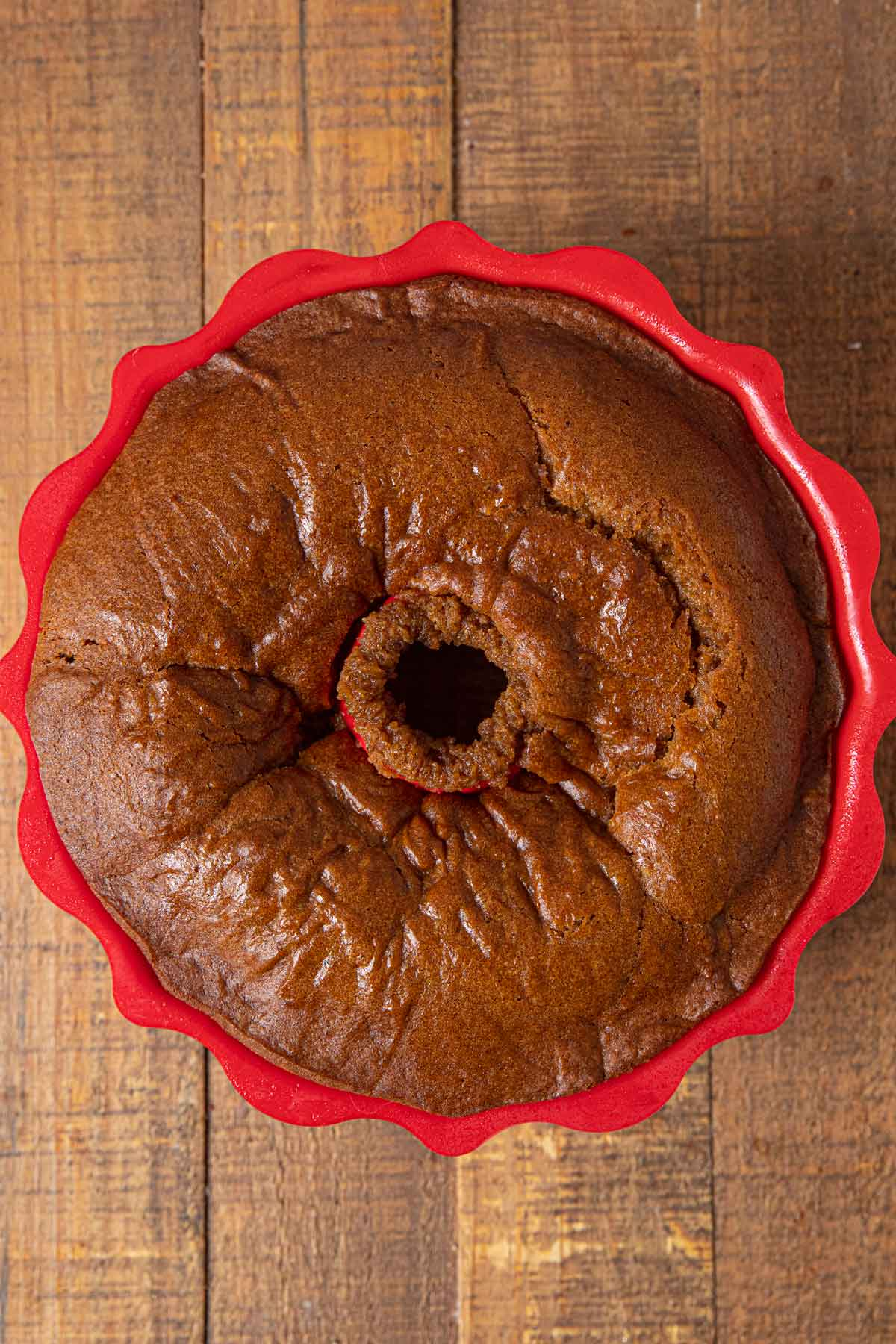Pumpkin Bundt Cake baked in red silicone bundt cake pan