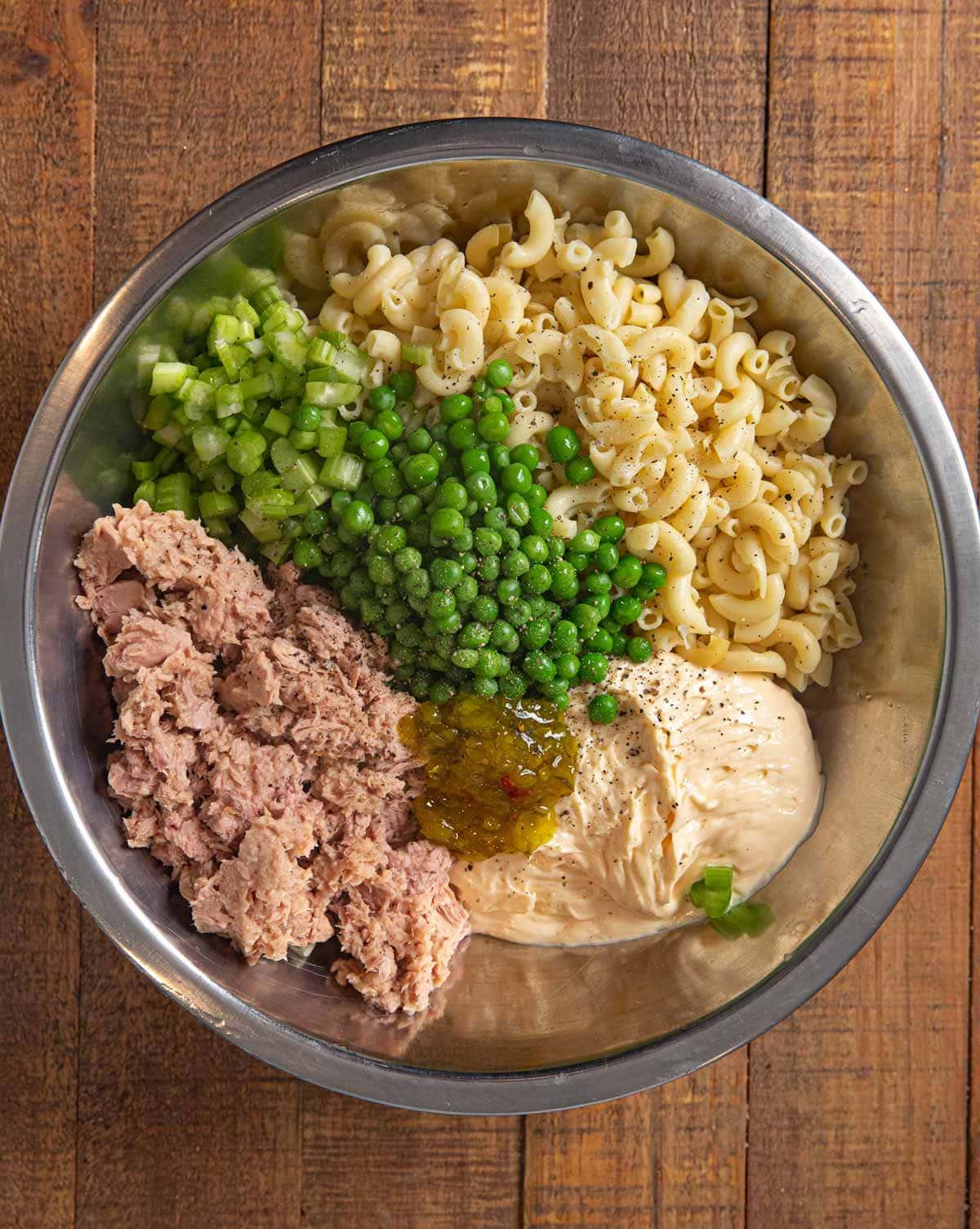 Tuna Pasta Salad ingredients in metal mixing bowl