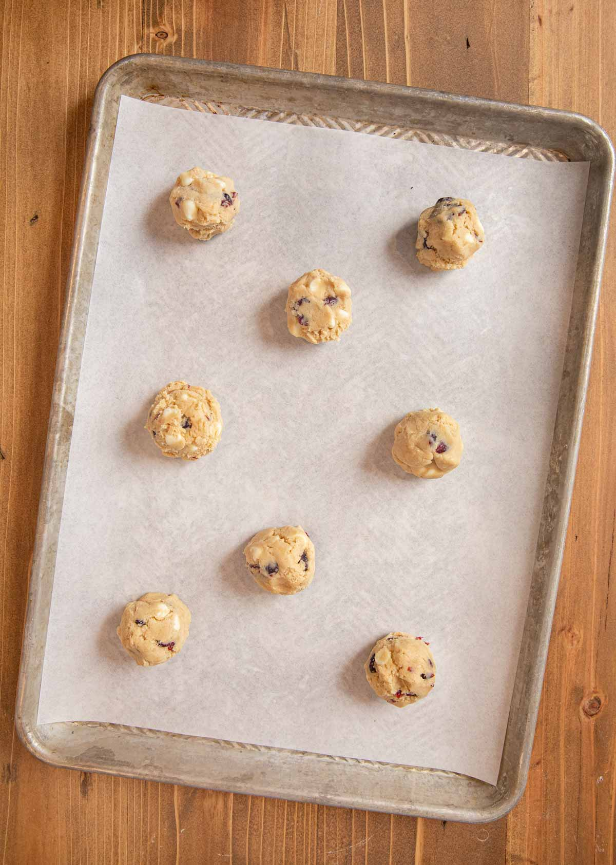 White Chocolate Cranberry Cookies dough balls on cookie sheet