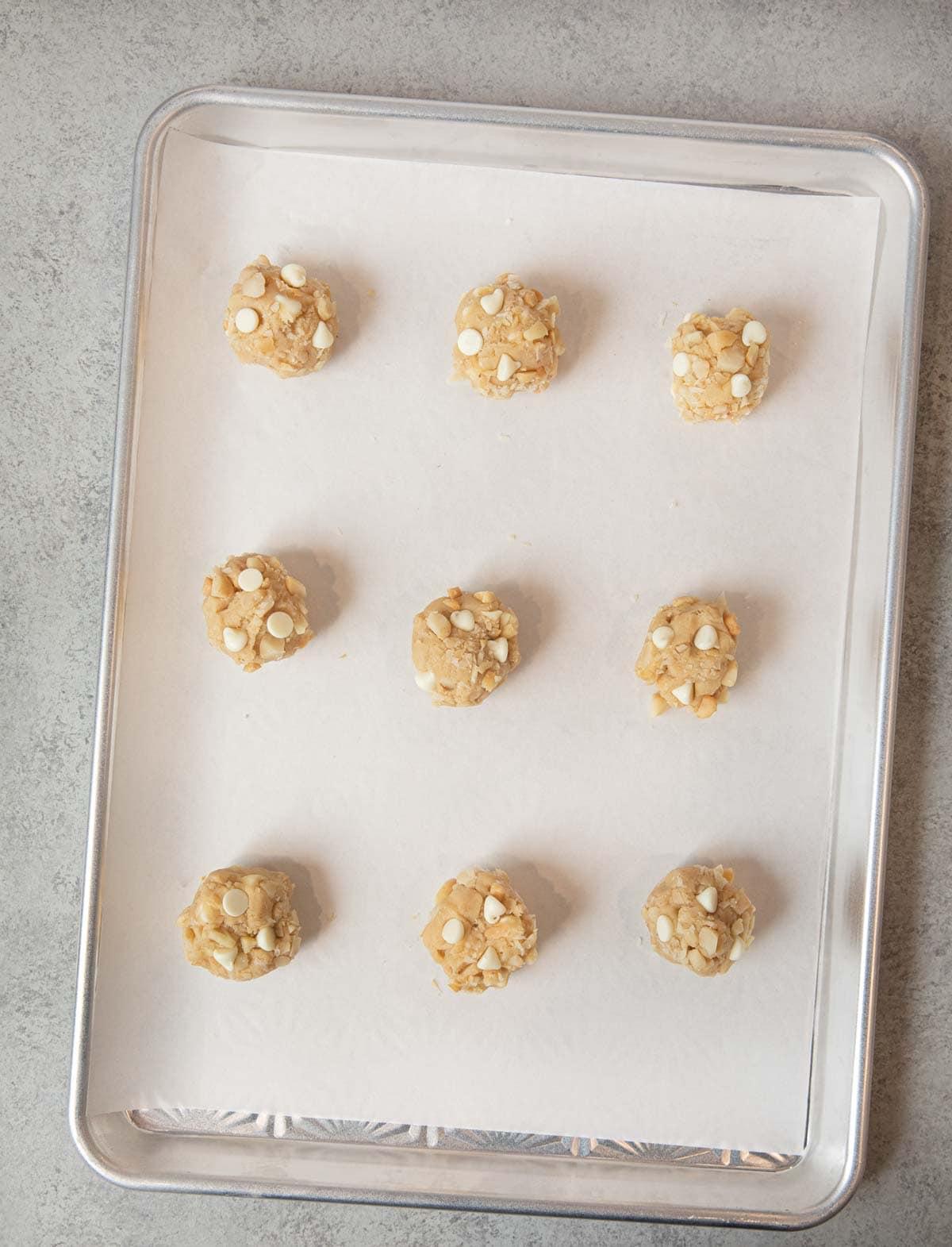 White Chocolate Macadamia Chip Cookies dough balls on baking sheet