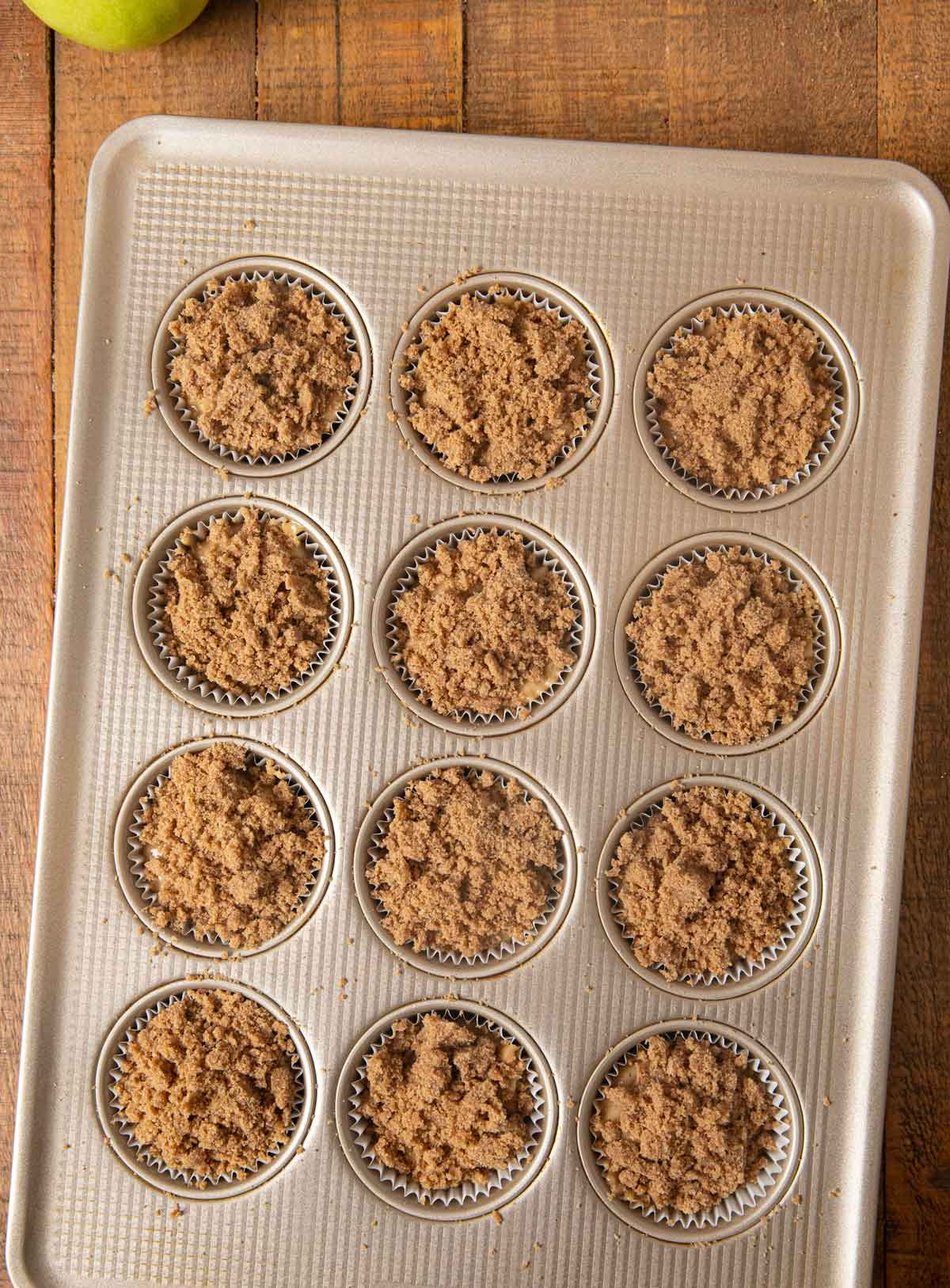 Apple Pie Muffins batter in cupcake tin before baking