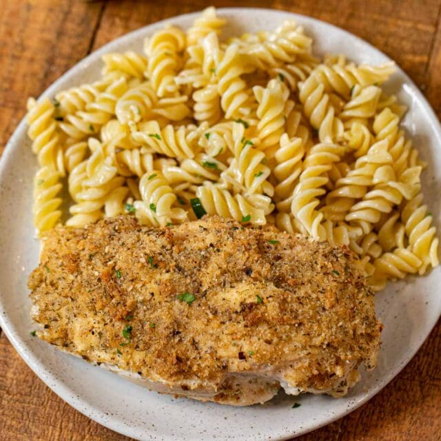 Baked Sour Cream Chicken on plate with pasta