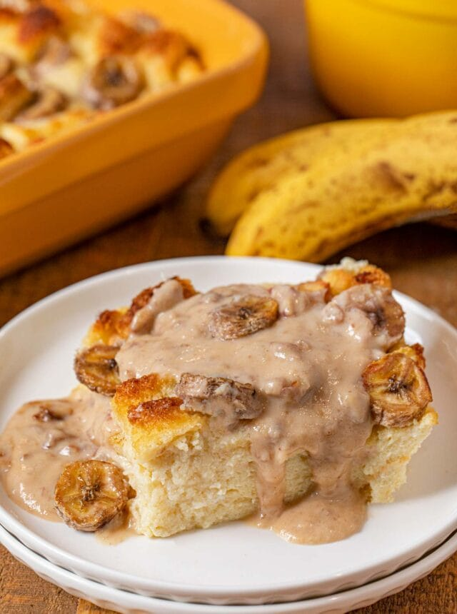 Banana Bread Pudding serving on plate with pecan vanilla sauce