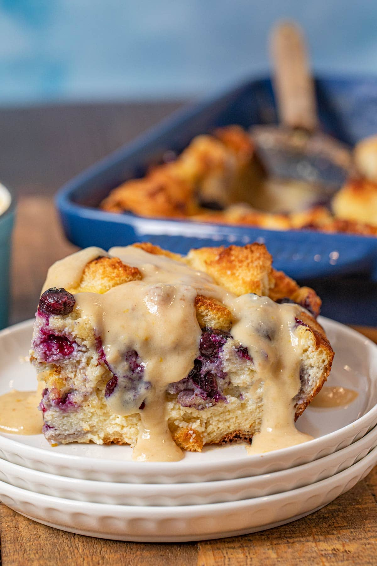 Blueberry Bread Pudding serving on plate with lemon-vanilla glaze