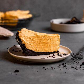 Chocolate Oreo Pumpkin Whip Pie slice on plate