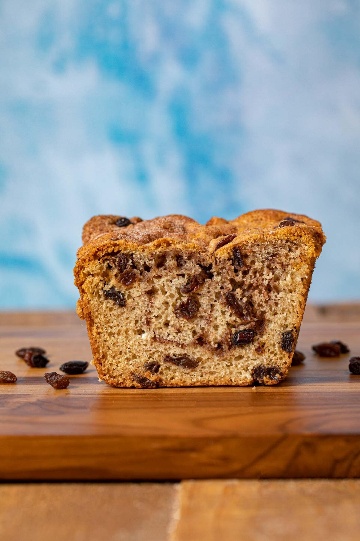 Cinnamon Raisin Bread cross-section on cutting board