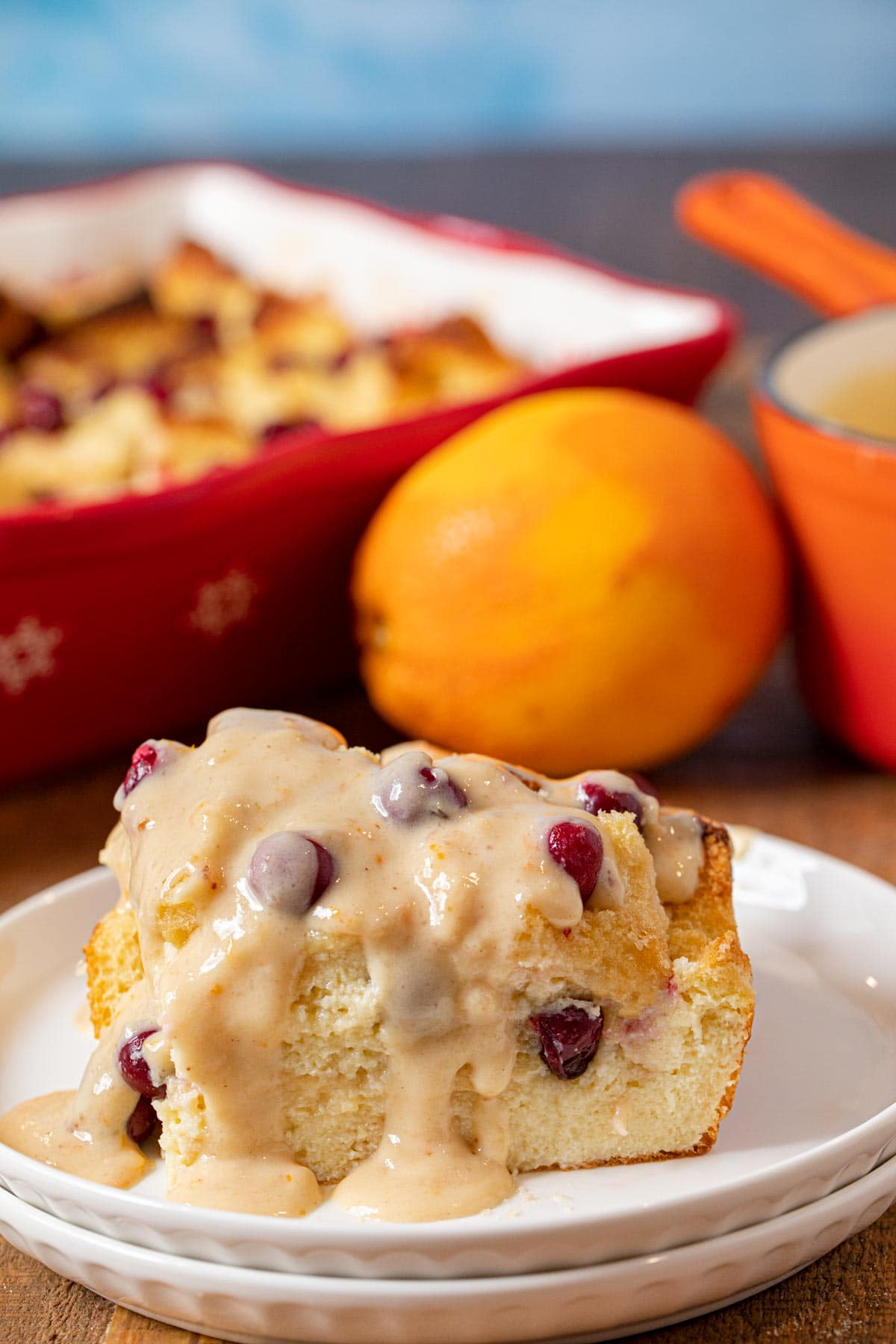 Cranberry Bread Pudding serving on plate with orange vanilla sauce