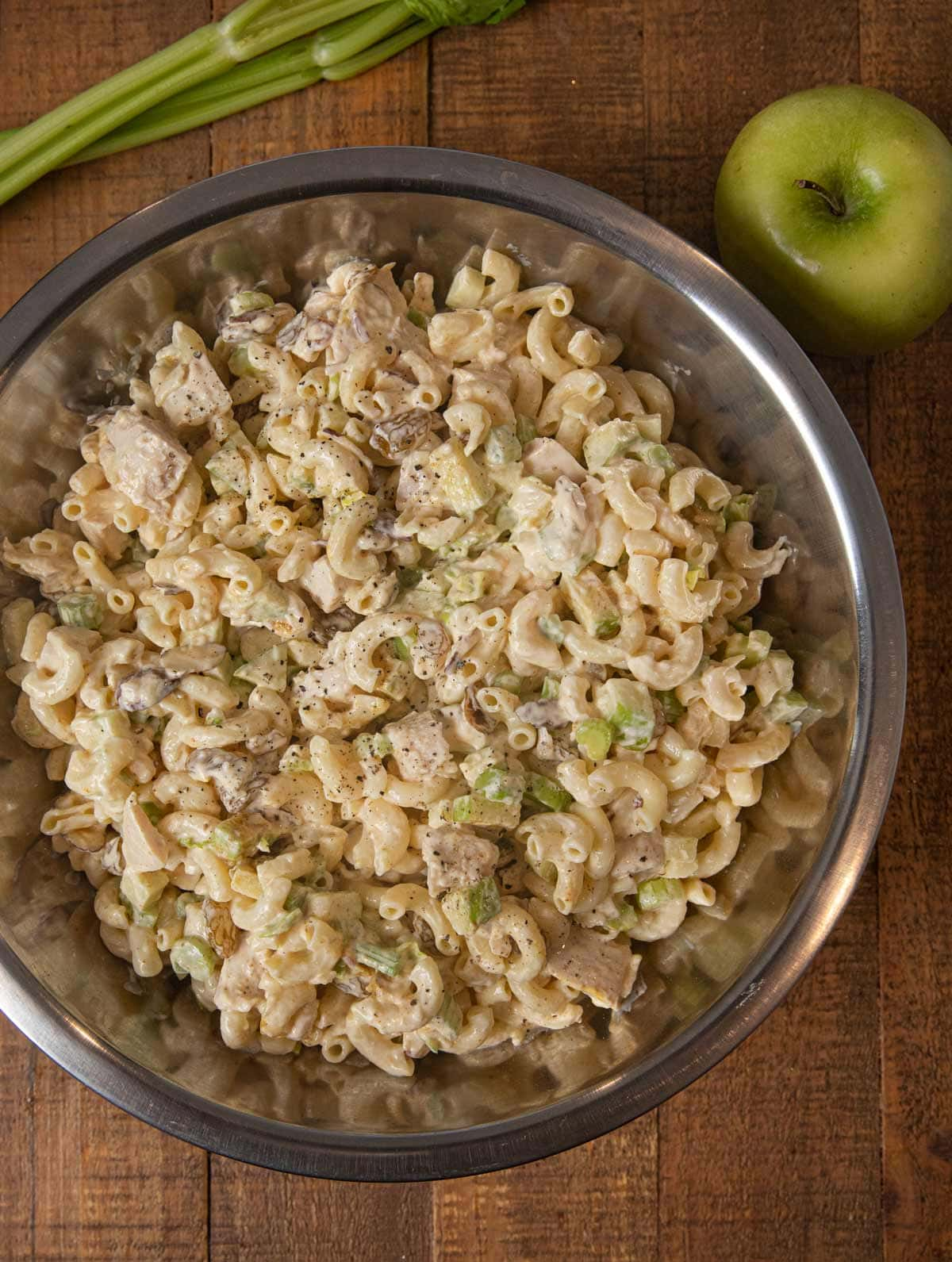 Curried Chicken Pasta Salad mixed in mixing bowl
