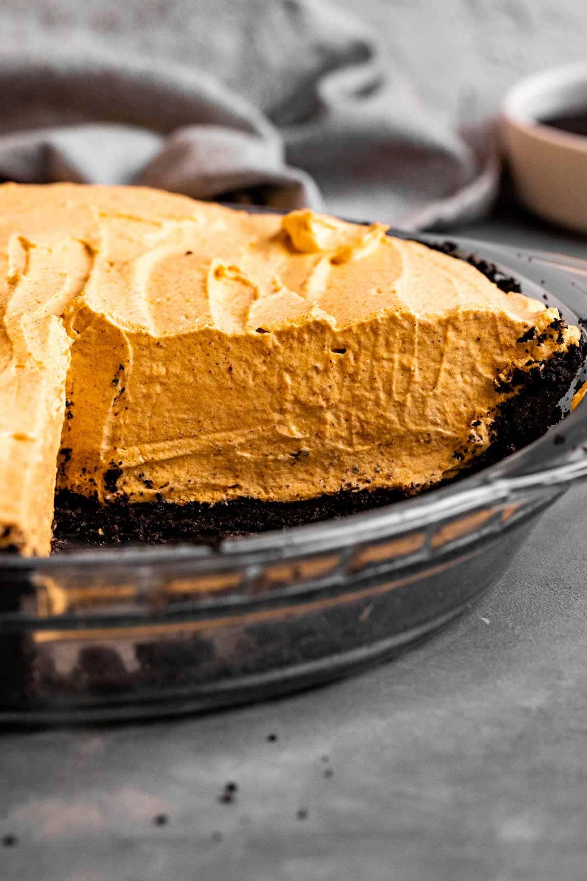 Chocolate Oreo Pumpkin Whip Pie in pie dish sliced