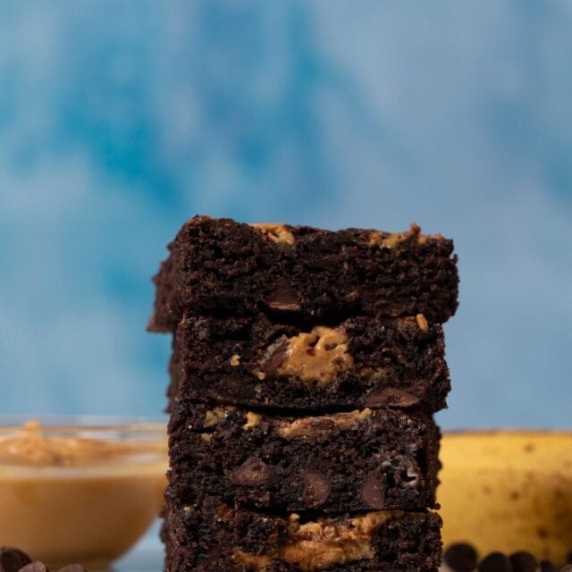 Peanut Butter Chocolate Banana Brownies in stack