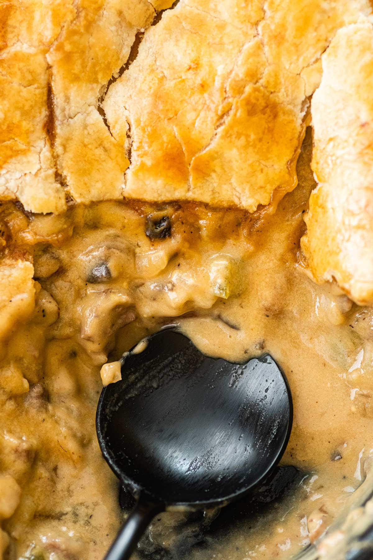 Philly Cheesesteak Pot Pie sliced open with spoon