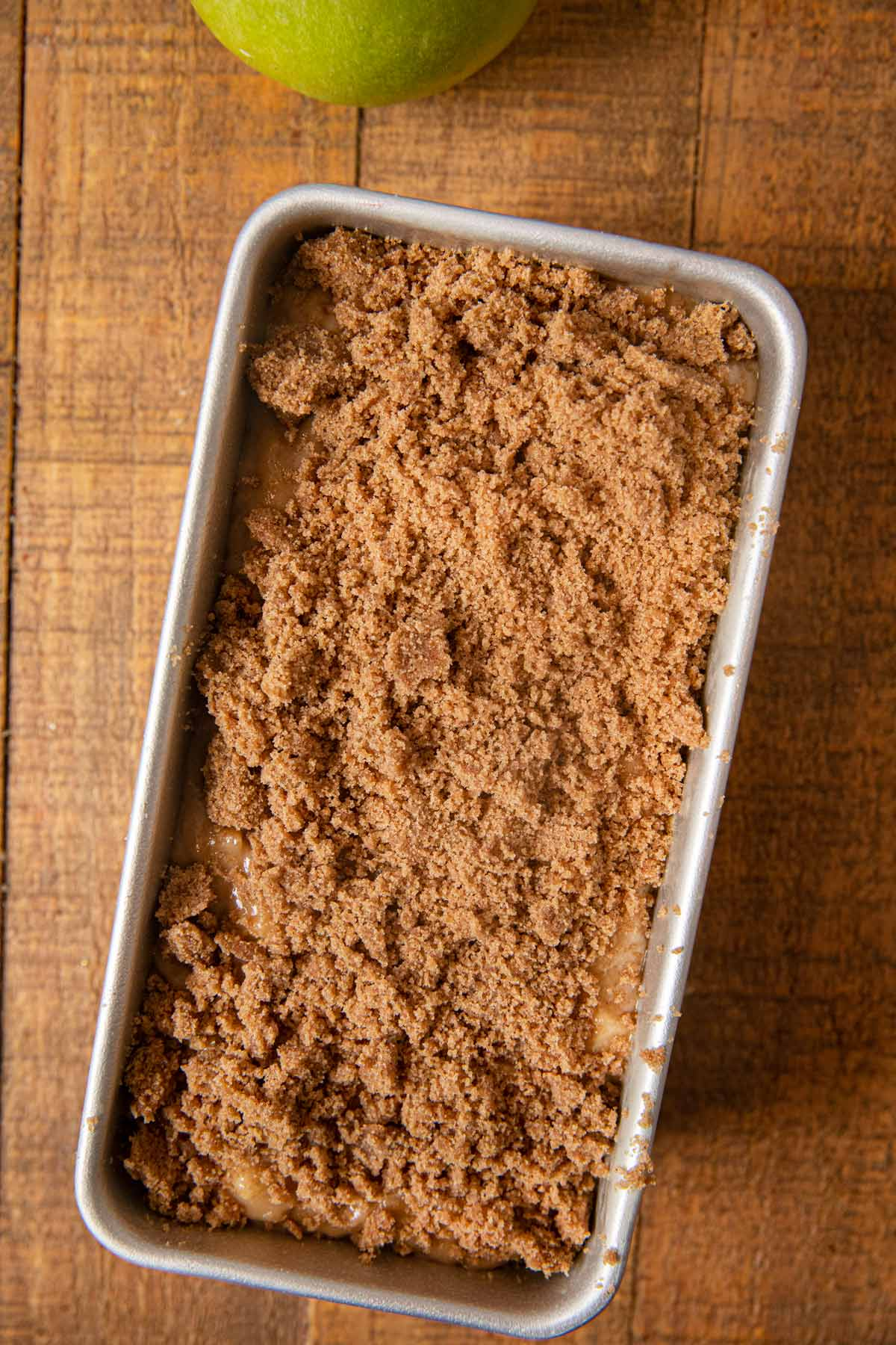 Apple Pie Bread batter and topping in baking pan before baking