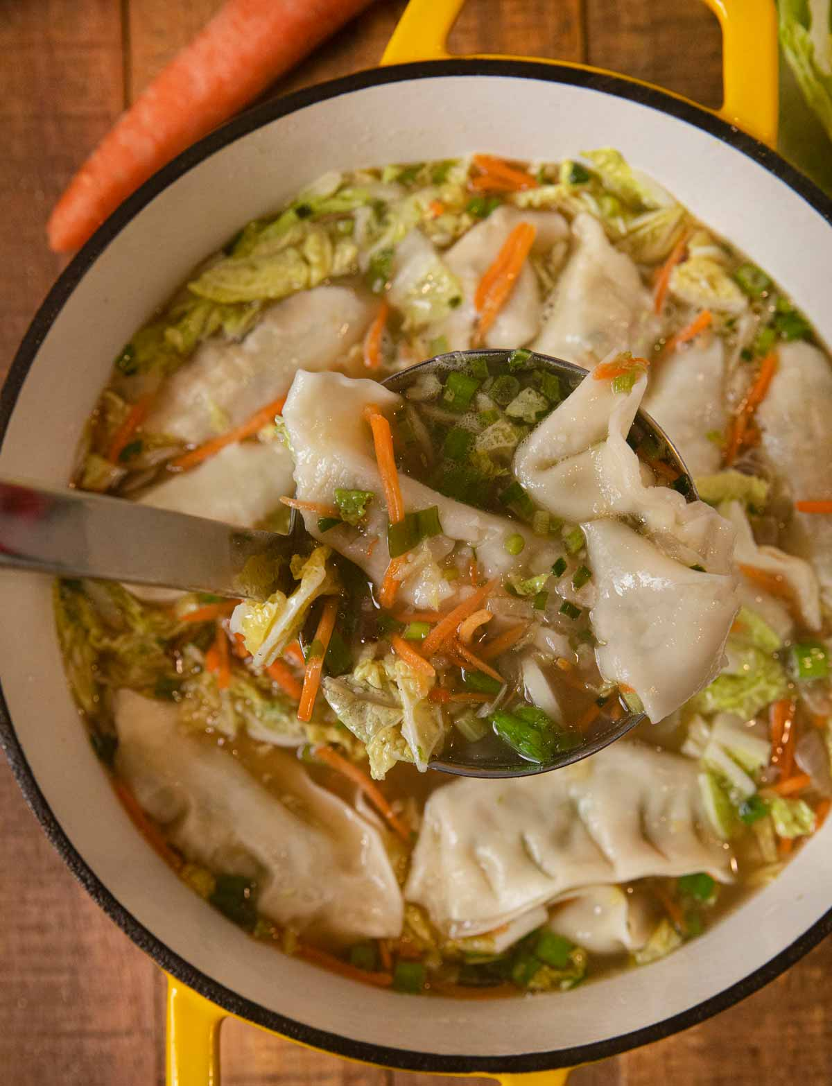 Asian Potsticker Soup serving in ladle