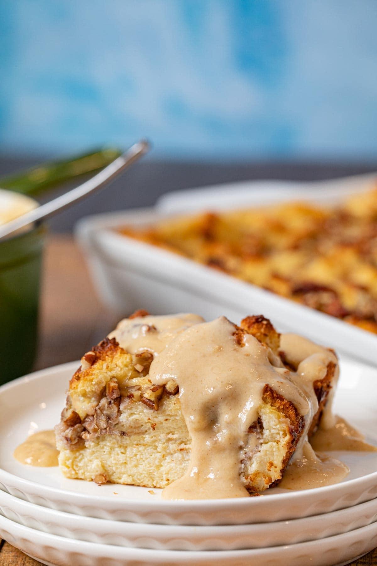 Bourbon Pecan Bread Pudding serving on plate with bourbon vanilla sauce