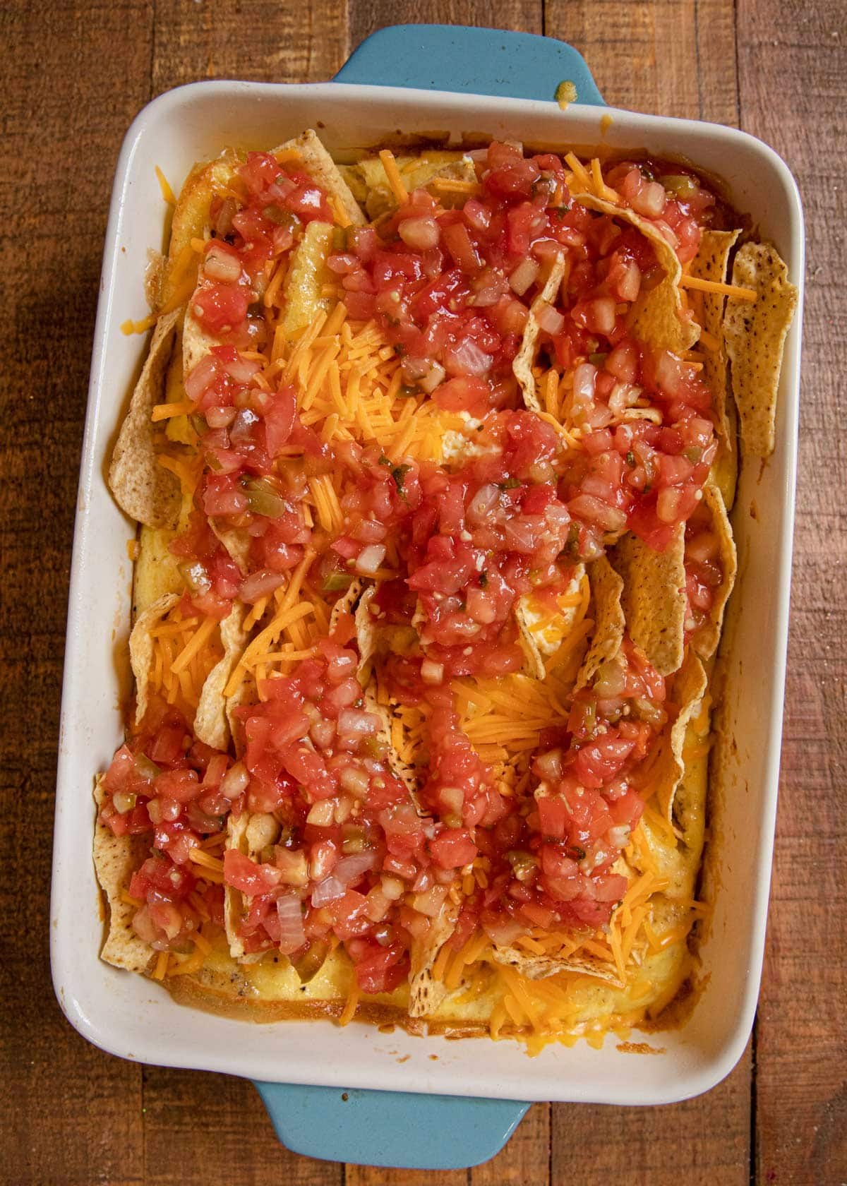 Cheesy Baked Chilaquiles in baking dish before baking