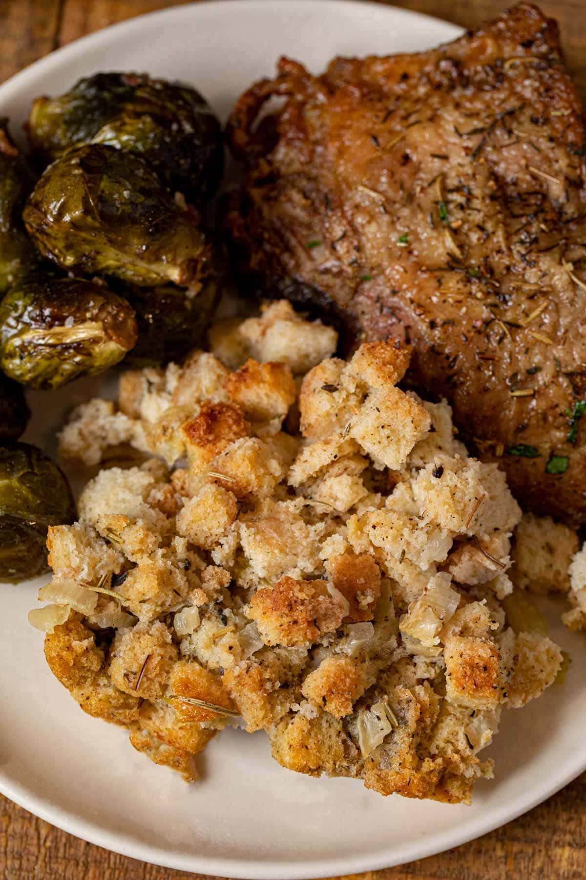 Classic Cube Stuffing on plate with turkey and Brussels sprouts