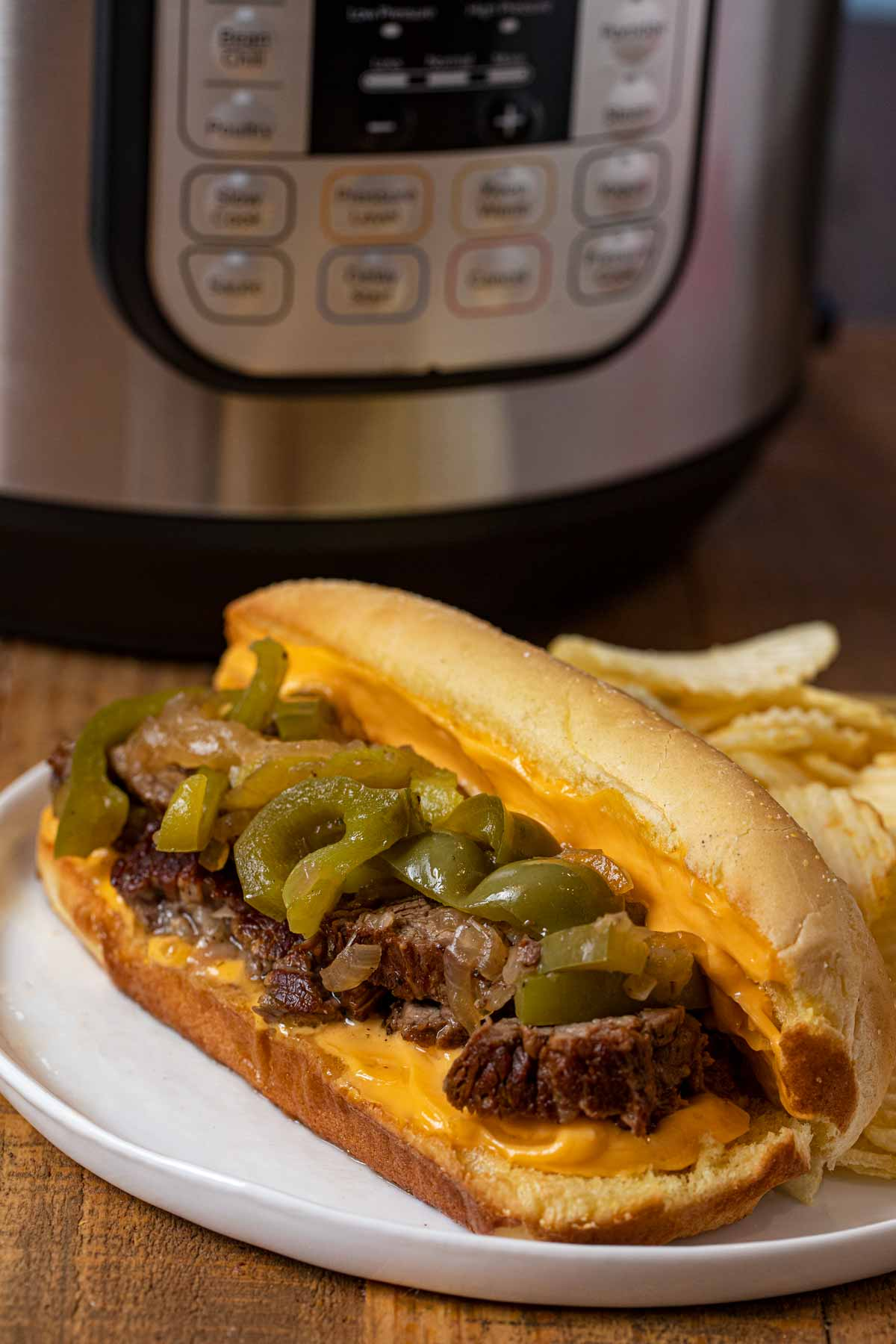 Instant Pot Philly Cheese Steak Sandwich on plate with cheese whiz
