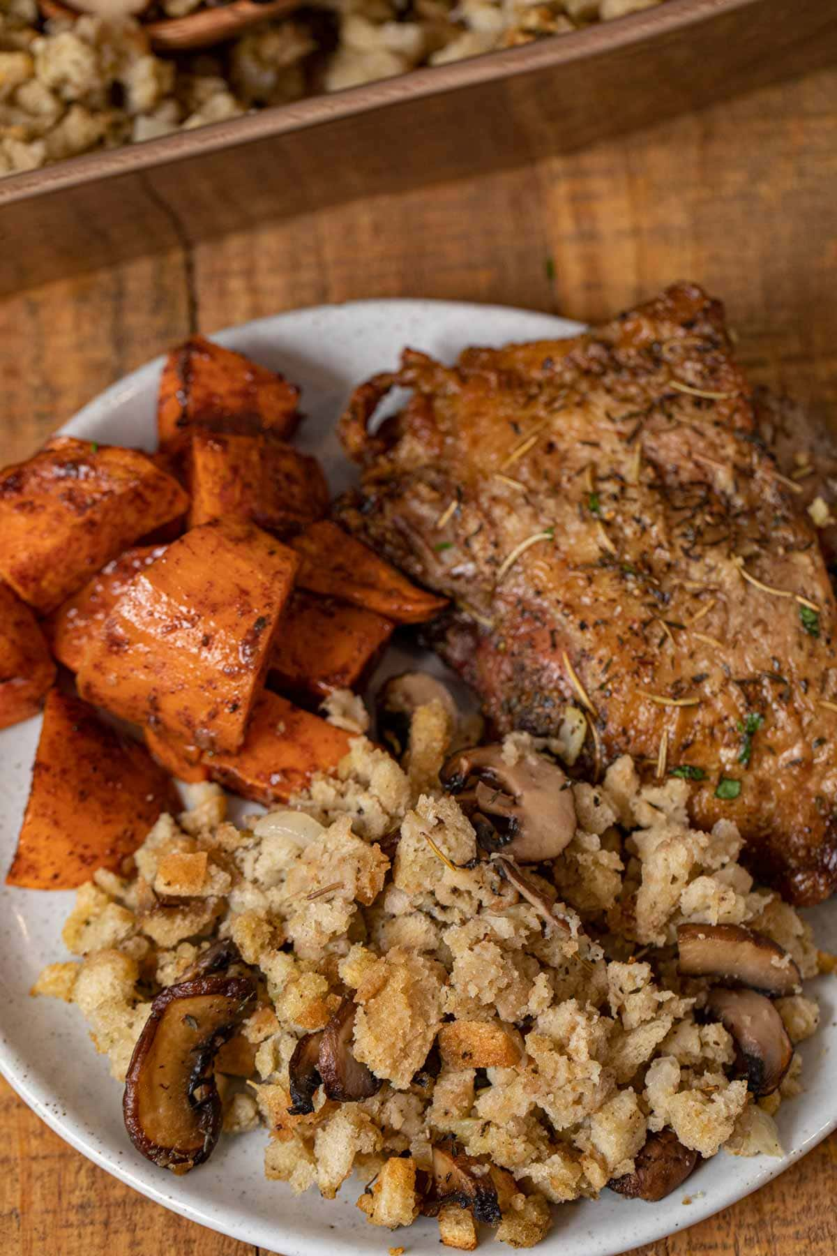Mushroom Bread Pudding on plate with turkey and sweet potatoes