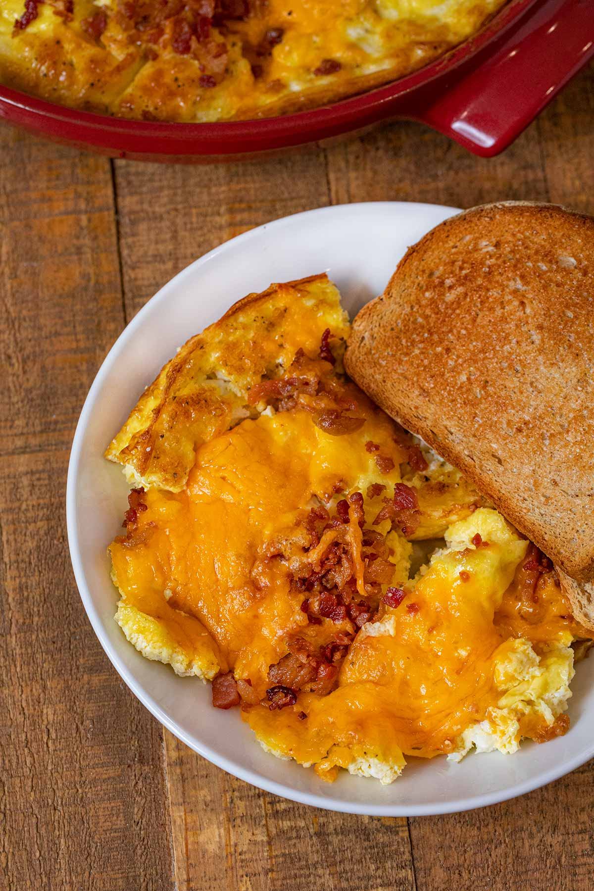 Oven Baked Cheddar Scrambled Eggs serving on plate