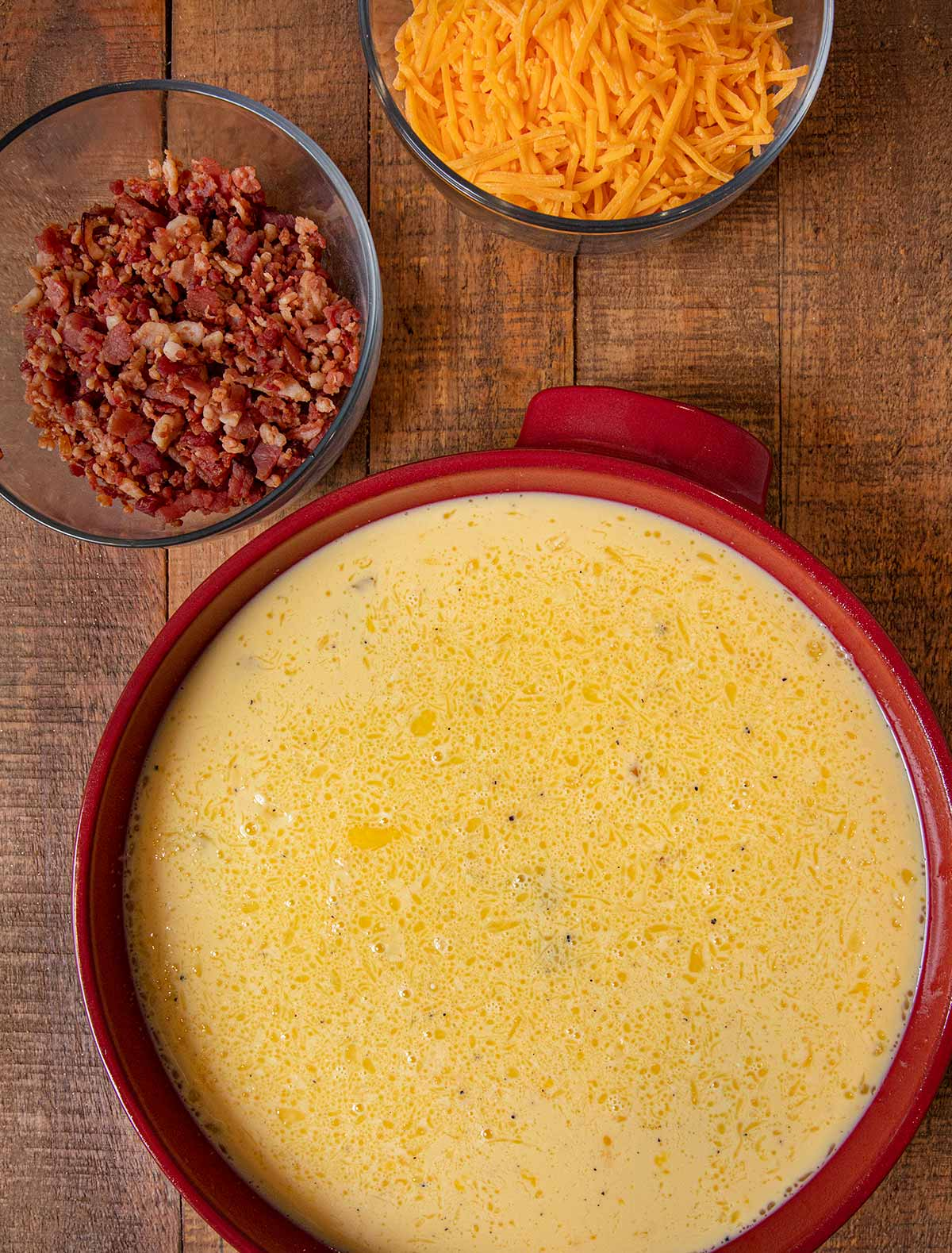 Oven Baked Cheddar Scrambled Eggs ingredients in bowls