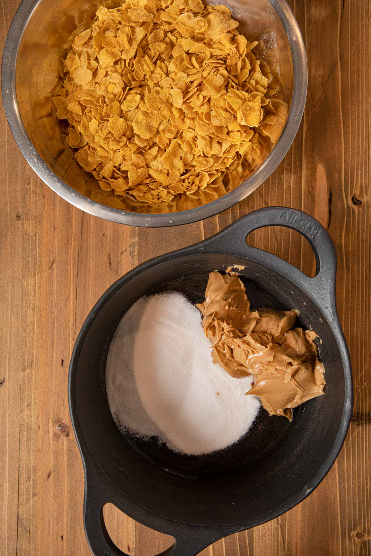 Peanut Butter Cornflake Bars peanut butter and sugar in pot with cornflakes in bowl
