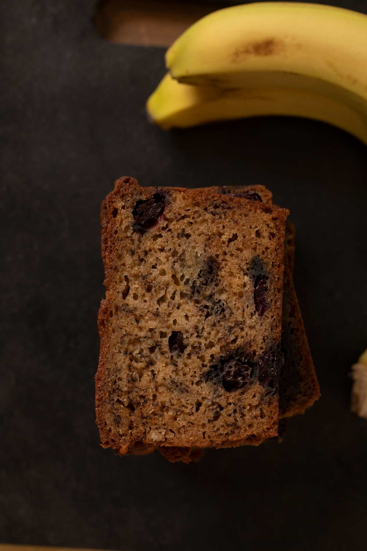 top-down view of Blueberry Banana Bread slices in stack