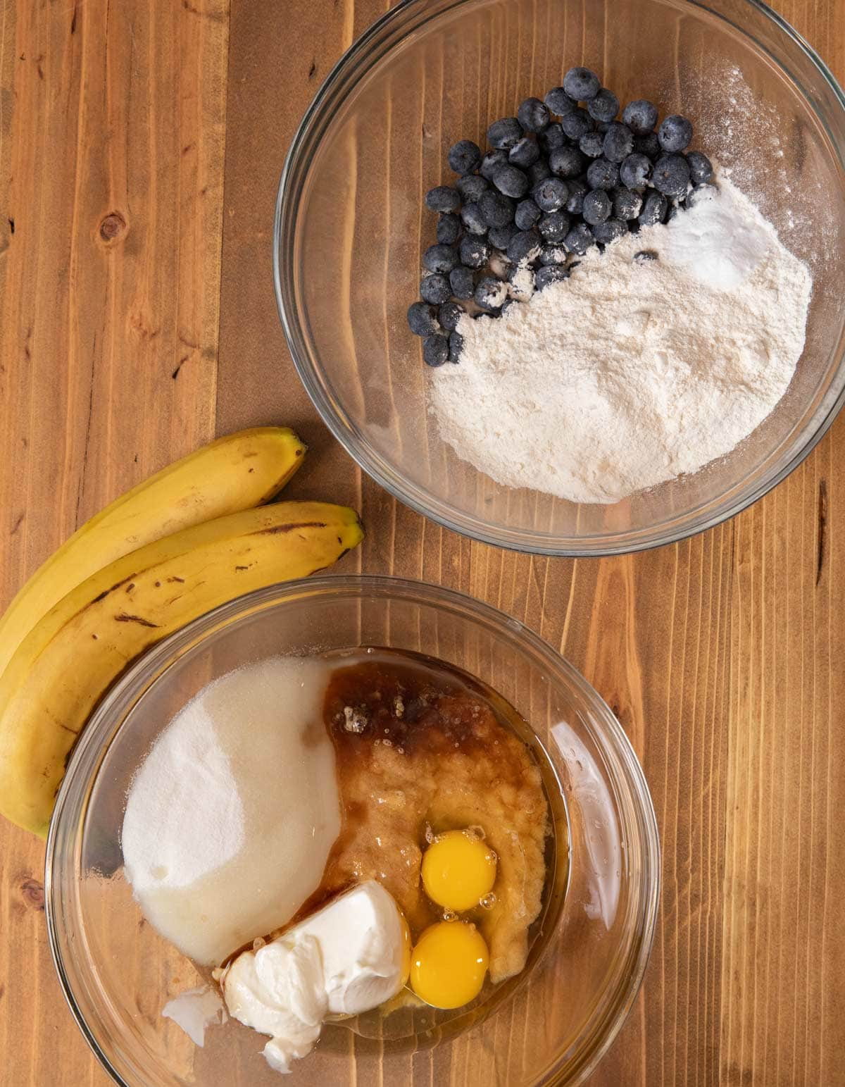 Blueberry Banana Bread ingredients in mixing bowls