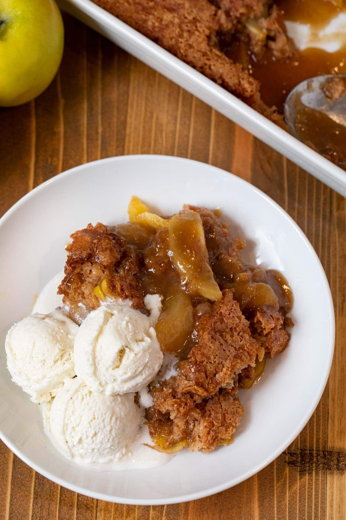 Caramel Apple Cobbler on a plate with vanilla ice cream