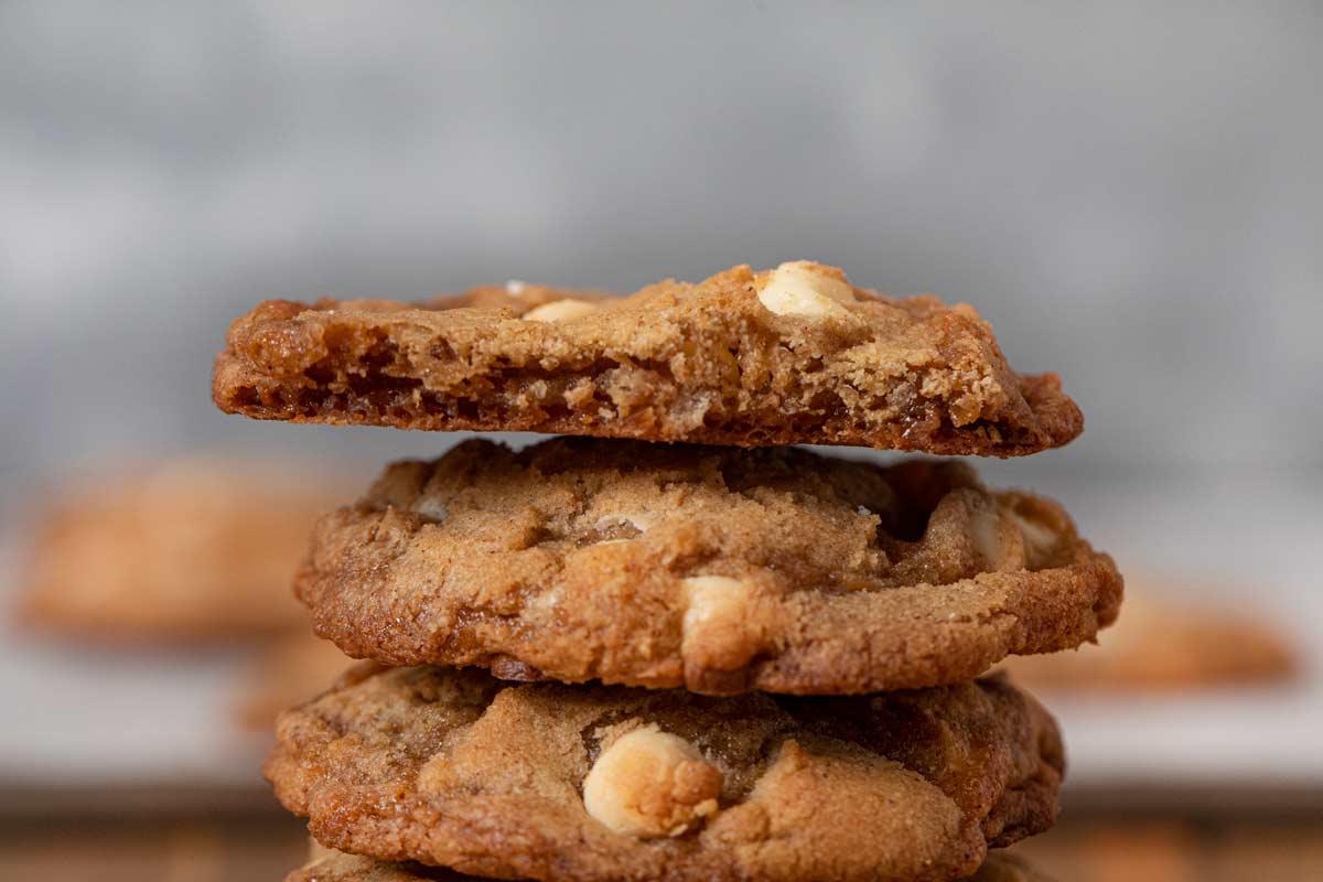 Cinnamon Crisp Cookies in stack with bitten cookie on top