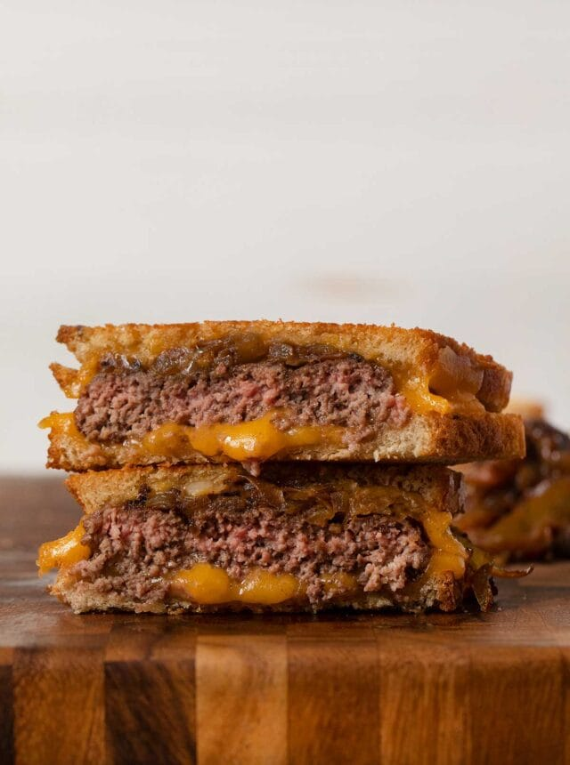Classic Patty Melt sandwich halves in stack