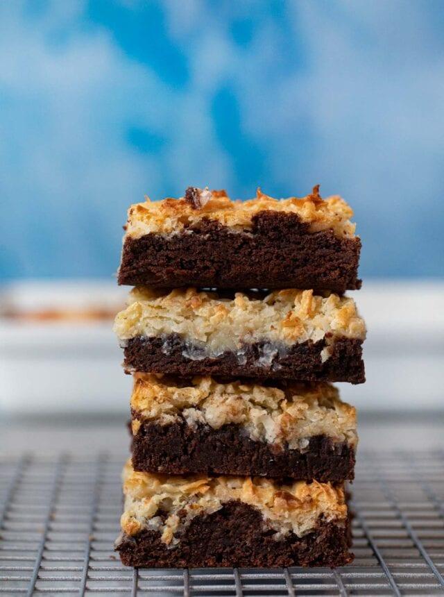 Coconut Macaroon Brownies on metal cooling rack in a stack