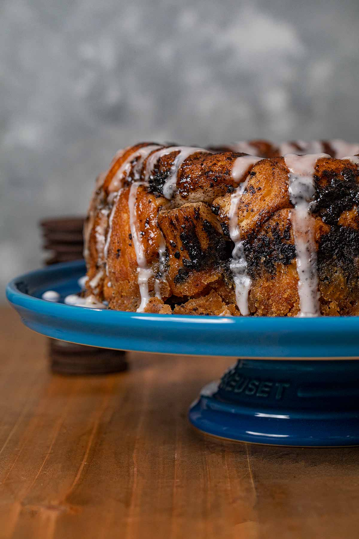 Side angle of Oreo Monkey Bread on blue cake stand