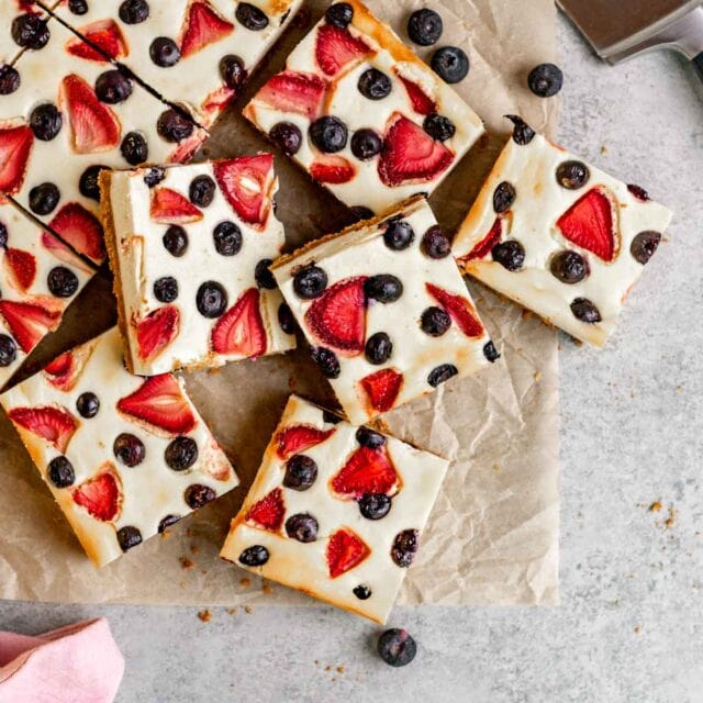 Red White and Blue Cheesecake Bars on parchment