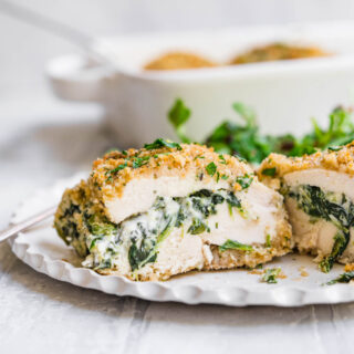 Stuffed Chicken Breast on dinner plate with salad