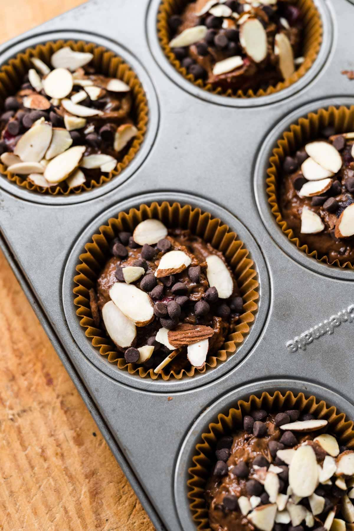 Almond Cherry Chocolate Muffins batter in muffin pan