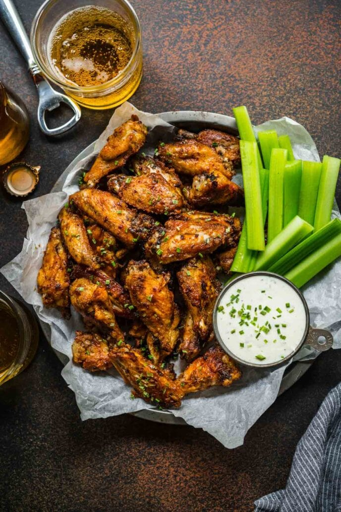 Baked Chicken Wings on serving plate with celery and creamy dip