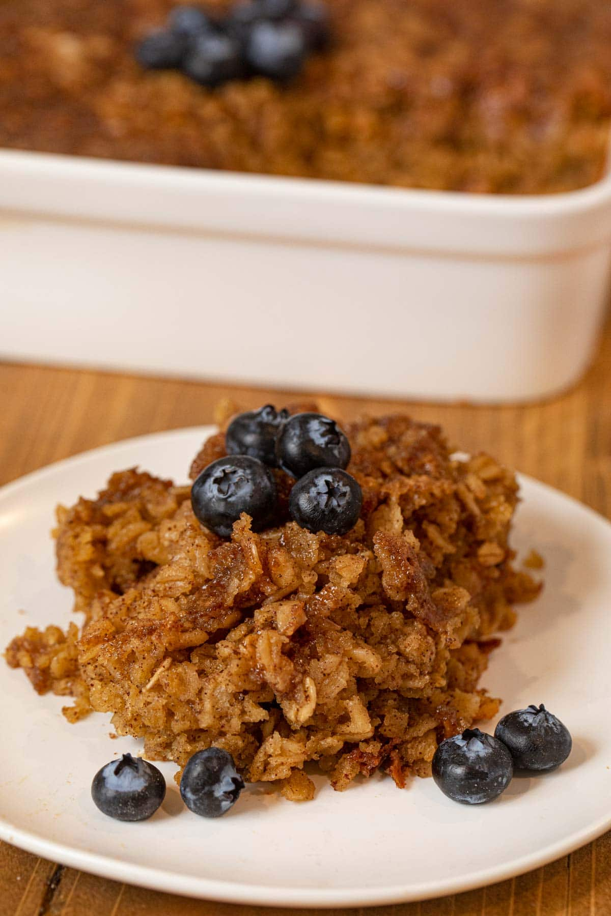 Baked Oatmeal on plate with blueberries