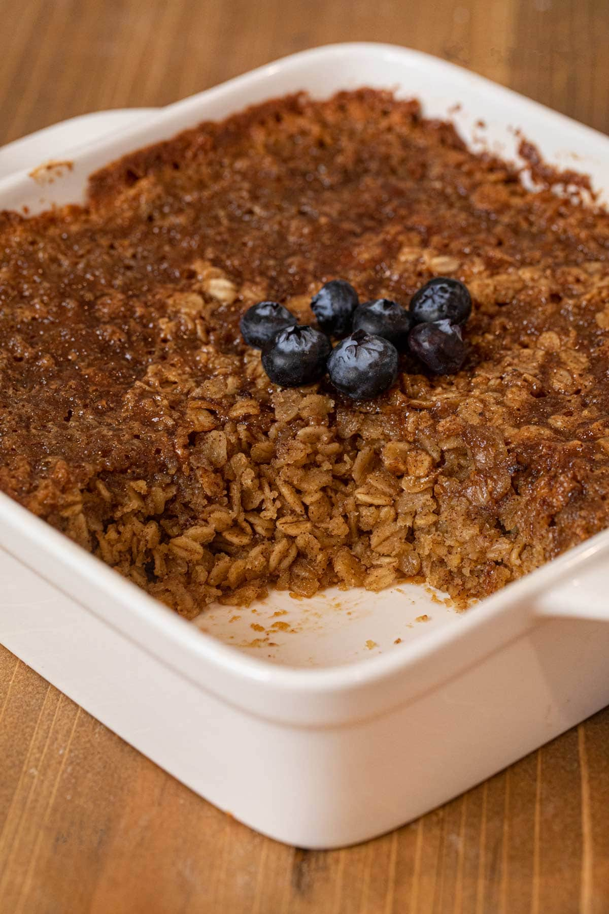 Baked Oatmeal in baking dish with portion removed