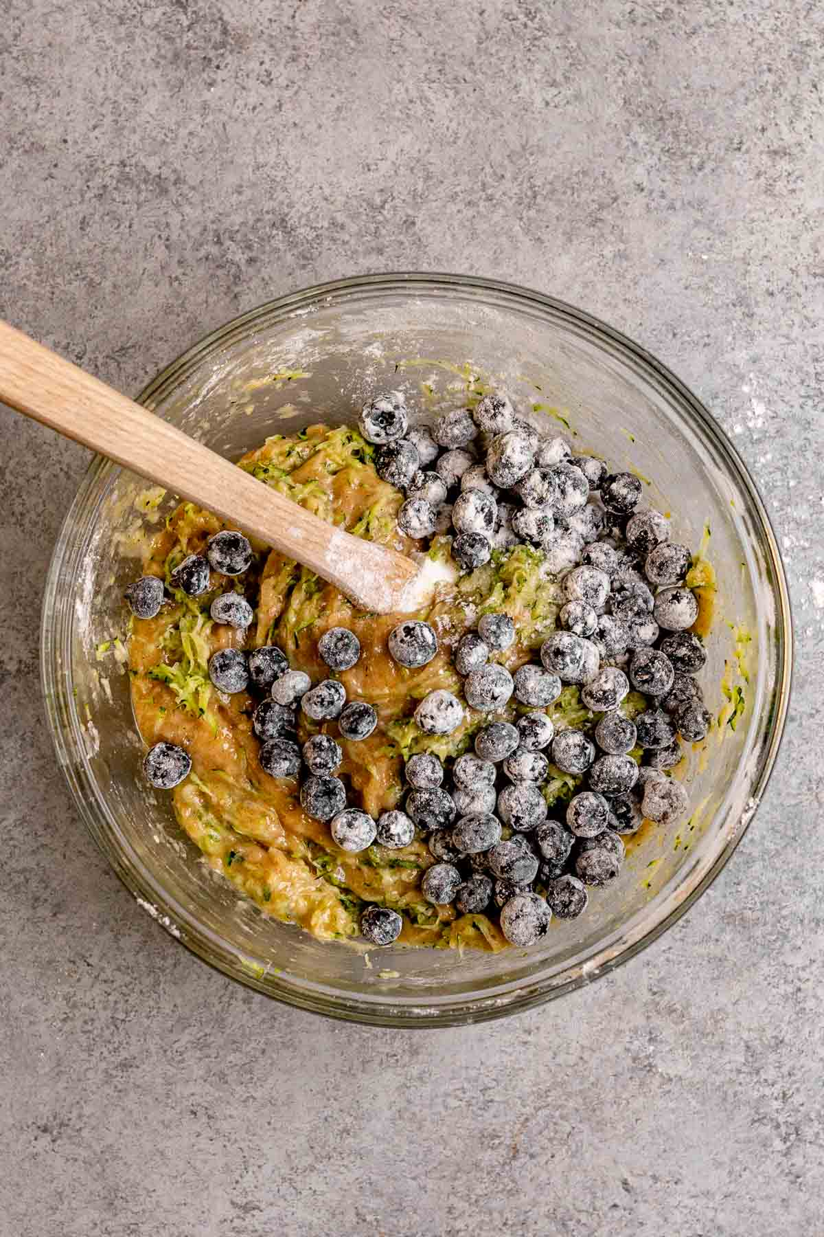 Blueberries added to batter for Blueberry Zucchini Bread in mixing bowl