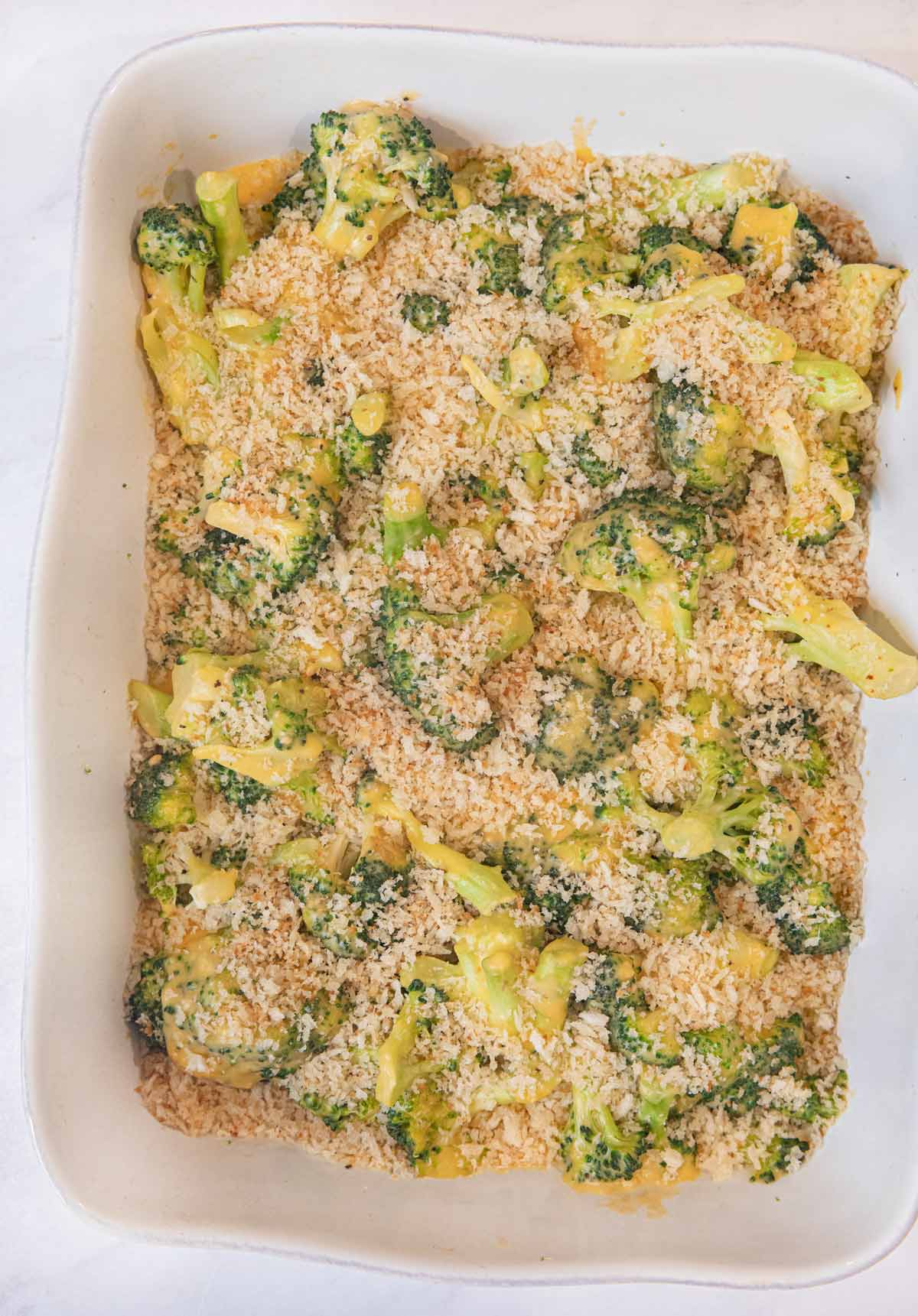 Cheesy Garlic Casserole in baking dish coated with bread crumbs before baking
