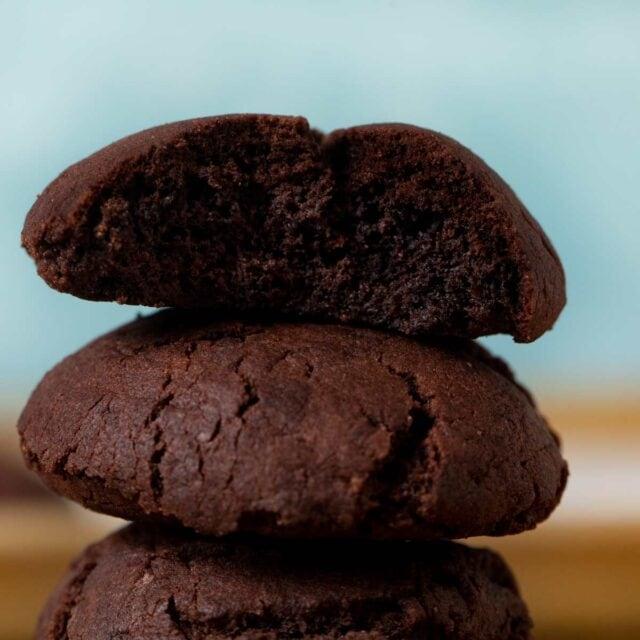 Chocolate Drop Cookies in stack with bitten cookie on top