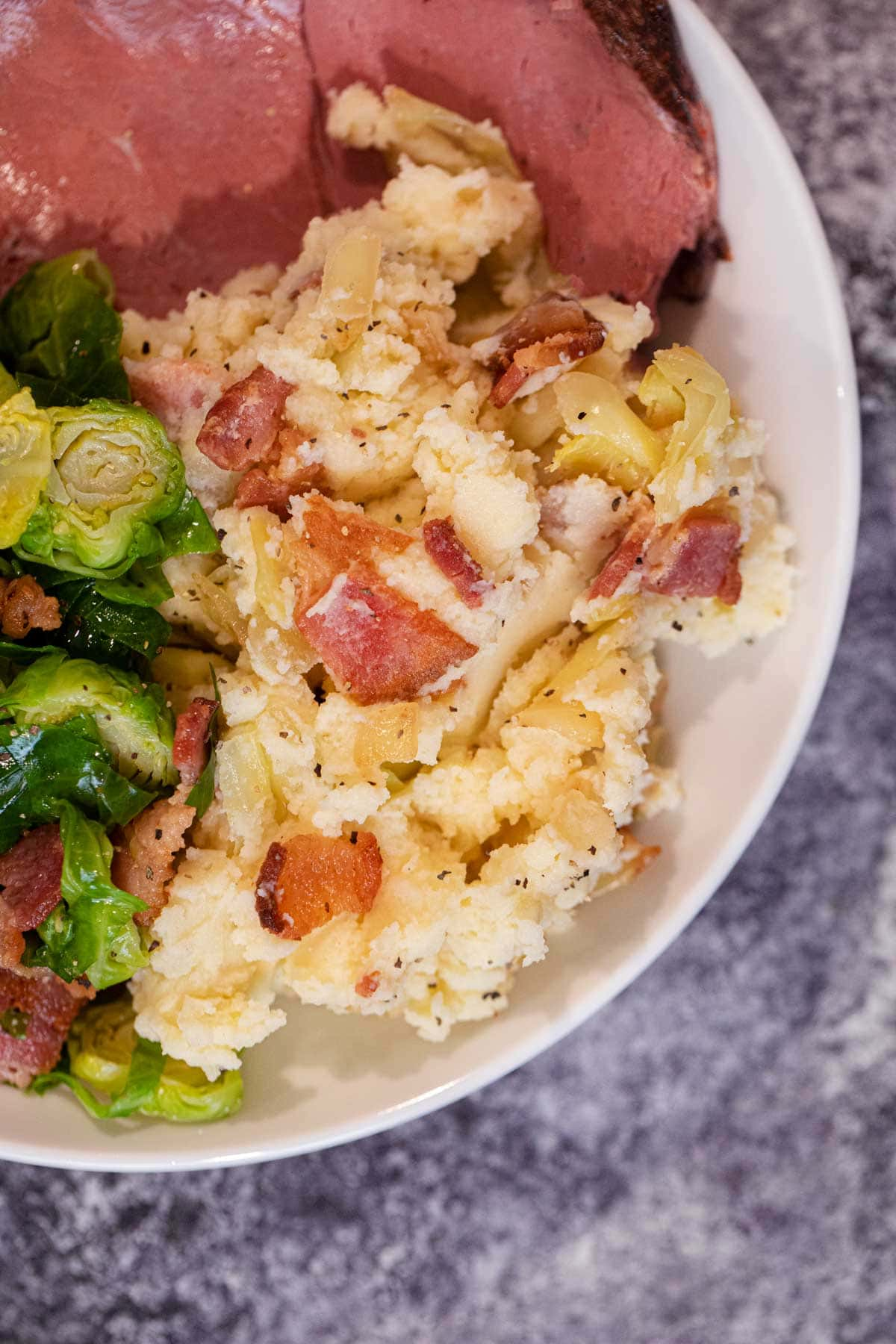 Colcannon Irish Potatoes on plate with ham and Brussels sprouts