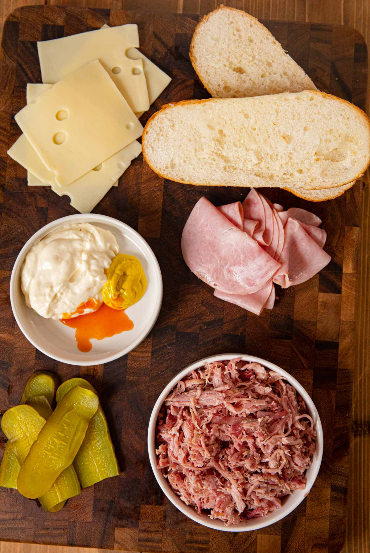 Cuban Sandwich ingredients spread out on large cutting board