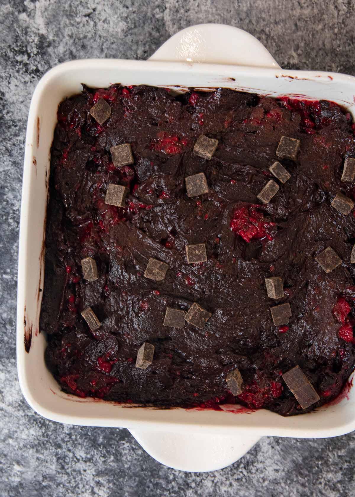 Dark Chocolate Raspberry Brownies batter in baking dish