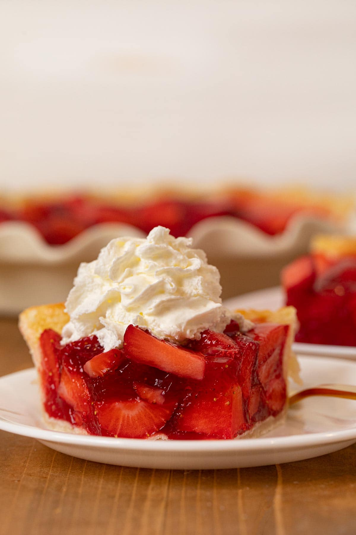 Fresh Strawberry Pie slice on plate with whipped cream