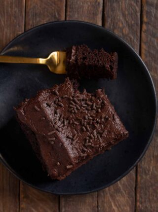 serving of Guinness Chocolate Sheet Cake with bite on fork